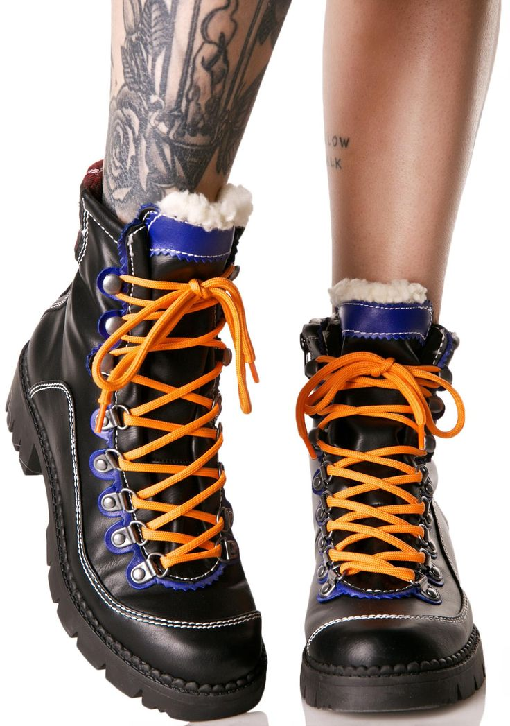 Lust For Life Alps Lace-Up Hiking Boots are gunna show you the view from the top, bb! These dope hiking style boots feature a smooth black vegan leather construction, thick D-ring hardware, blue trim, faux shearling lining, treaded sole, side zip closure, and neon orange lace-ups.