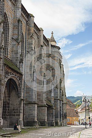 Black Church walls and courtyard, Brasov, Romania. The edifice was given its new name, Black Church, after  the Great Fire set by Hapsburg invaders in 1689, which leveled most of the town, heavily damaged the church, blackening its walls. Restoration took almost 100 years.