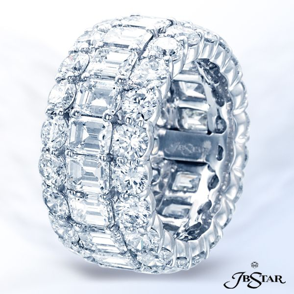 Style 2389 Platinum diamond eternity band is graced by emerald-cut diamonds in the center and round diamonds embracing the center in shared prong setting.