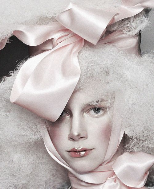 deprincessed:  Model wearing an exaggerated baby pink bow on the runway at John Galliano S/S 2009