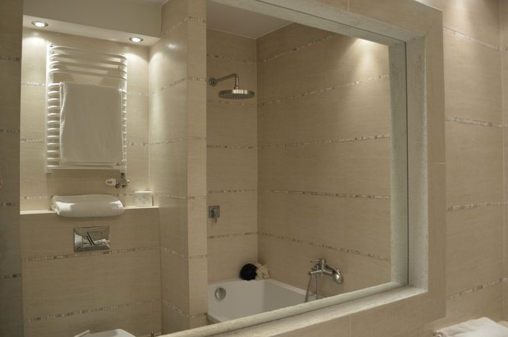 Bathroom with bathtub and shower in one