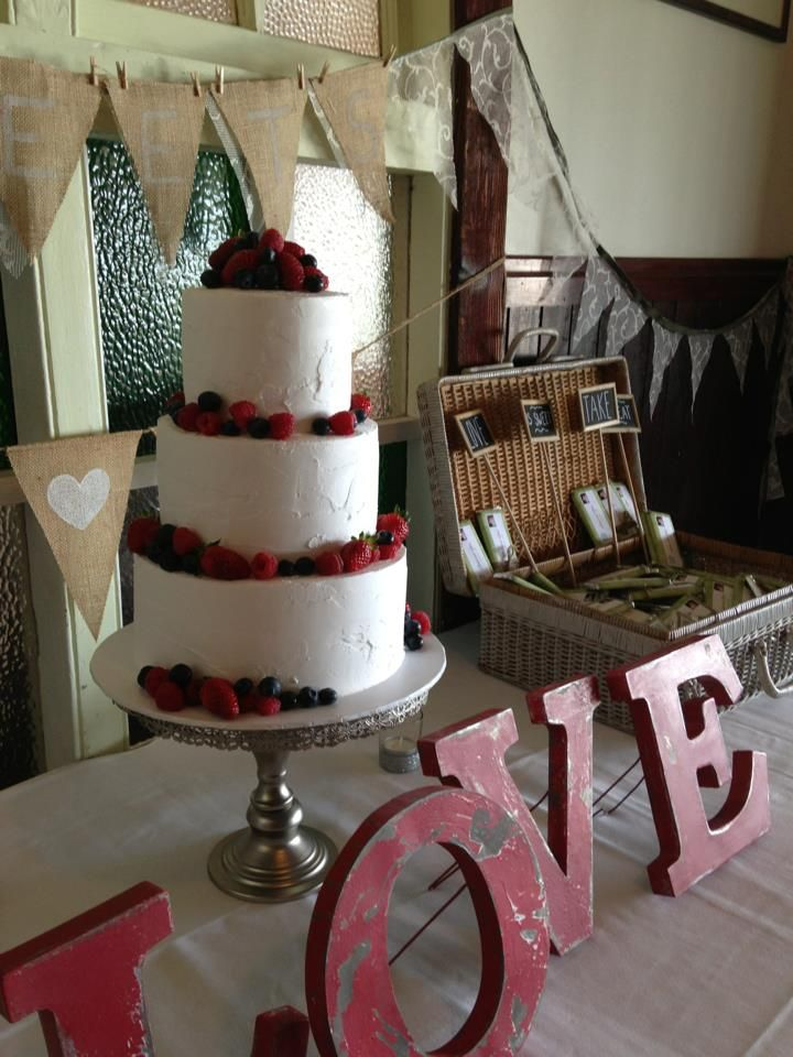 three tier with pure white buttercream and fresh berries by Let Them Eat Cake Byron Bay.