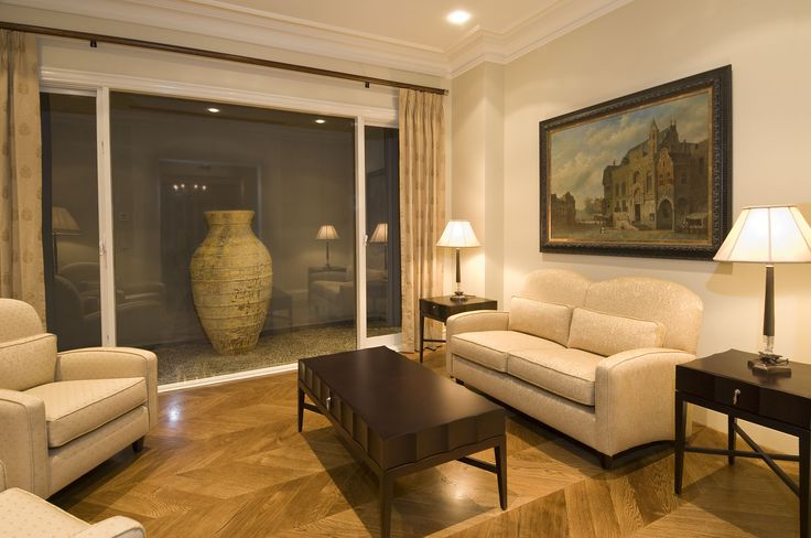 Living Room With Chevron Pattern Parquetry And Gallery Window. Ravida- Property With Distinction