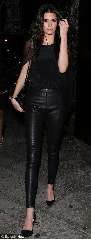 Beautiful in black: Kendall Jenner and Khloe Kardashian both chose to step out in the super slimming shade