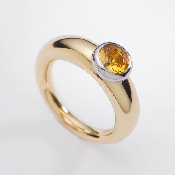 18ct yellow gold engagement ring with, chunky tapered with 1ct round yellow sapphire. Engagement rings Cork city.