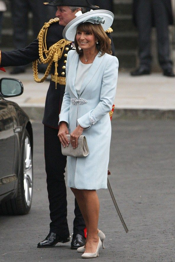 Carole Middleton, the mother of the bride, in a pale blue Catherine Walker coat dress and hat by Berkshire-based milliner Jane Corbett.