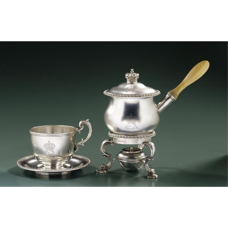 A Victorian Royal silver chocolate cup and saucer with warming pan, burner and stand, Robert Garrard, London, 1845 the cup and saucer, warming pan, and burner engraved with the cypher EA, the warming pan and saucer inscribed Presented by Their Royal Highnesses the Duchess of Gloucester and Princess Sophia, 21 September 1845. The cypher is that of Ernest Augustus (1845-1923), Crown Prince of Hanover and Duke of Brunswick-Lüneburg, who was born on 21 September.