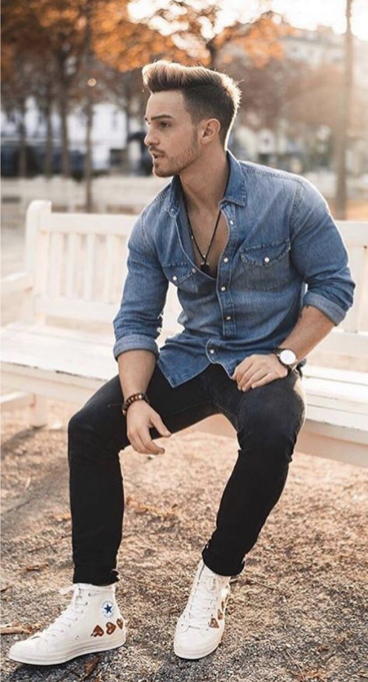 e09393670ce0 Summer outfit inspiration with blue denim button up shirt with rolled up  sleeves wrist accessories watch black denim white chuck taylor converse  high top ...