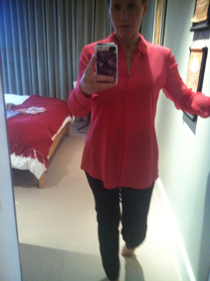 Coral blouse sheer sleeves, fitted black ankle pants