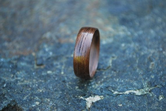 The Classic Black Walnut Bentwood Wood Ring. You will not be disappointed, with this classic piece. The grains in the wood are so visually appealing, it stands fierce, with or without an added inlay. Crafted with multiple layers of Black Walnut Veneer wrapped around itself. We do not coat the wood rings with any wax, but highly polished multiple layers of cyanoacrylate glue. All of our wood rings are hand cut and finished with hand tools, and then sanded to size and buffed to a smooth…