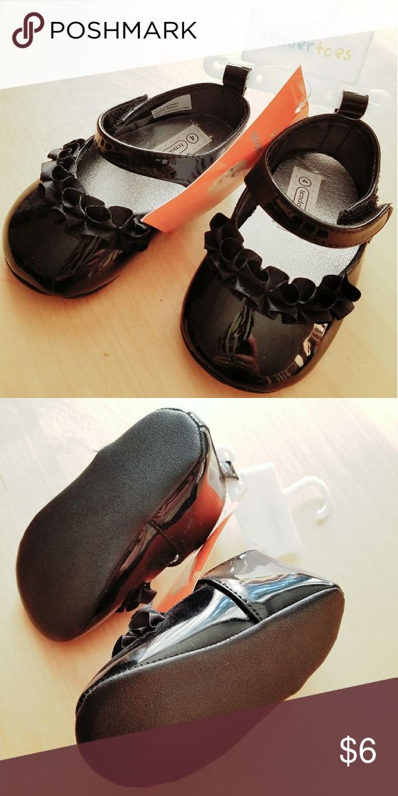 Toddler Size 4 brand new girl's black sandals Brand new with tags, never worn, girl's sandals. Toddler size 4. Velcro straps, silver lining, patent shiny black outer with black ribbon detail. Super cute! I forgot I had these shoes and my little was too big for them when they were found. Tendertoes Shoes Dress Shoes
