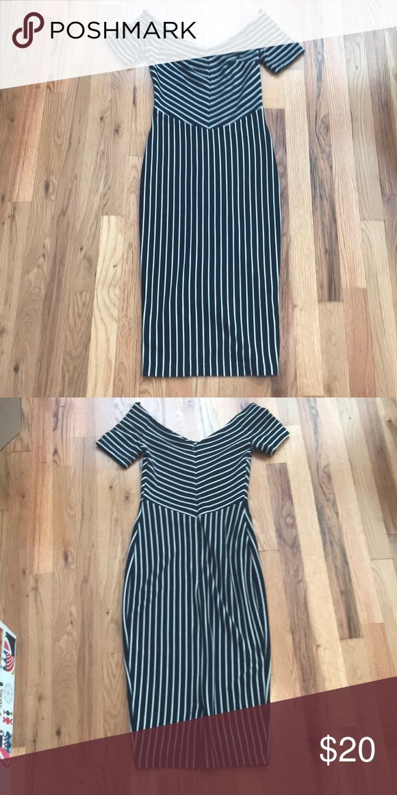 """ASOS Petite off the shoulder striped dress Adorable off the shoulder striped bodycon dress. This dress is so flattering! It is navy with cream strips and is fitted all the way down. It comes a little past the knee on me (I am 5'4"""" for reference) and has a slight slit on the back. The fabric is thick so it's very forgiving. Excellent condition, worn once. Non smoking home. ASOS Petite Dresses"""