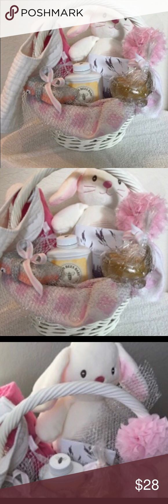 Newborn baby gift basket Welcome baby with this adorable white wicker basket! Lined with a receiving blanket, includes homemade peach and goat's milk soap, a plush toy, Burt's Bee talc-free powder, a bees wax candle (in a glass baby carriage), a cotton bib and stylish headband, scented with a lavender sachet. savvy gift box Other