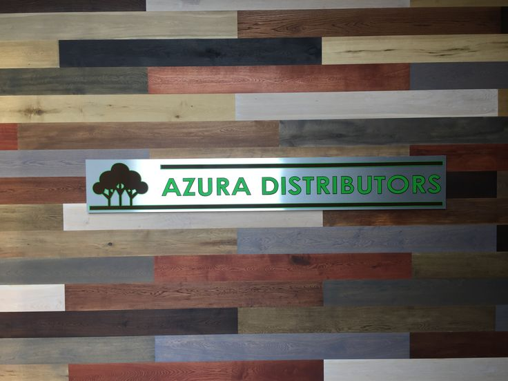 Visit our new website at www.azura.co.za   Azura Distributors wall feature in our showroom. #wood #laminate #signage #Feature #featurewall #showroom #engineeredwood #bamboo #LVT #WoodVinyl #Azura