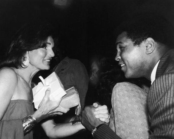 Jacqueline Kennedy Onassis greets Muhammad Ali at a party at the Rainbow Room in NYC on August 26, 1977.