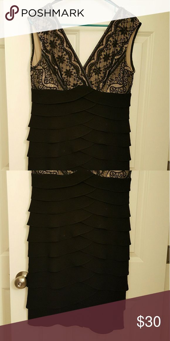 Women's black and tan lace formal dress sz 12 p Women's gorgeous sz 12 petite formal dress  Black lace with tan underlay on top  All black waterfall Ruffles on bottom hide a lot and make this very flattering!  Loved this!  Excellent condition. bought from Bonton  Dresses Mini