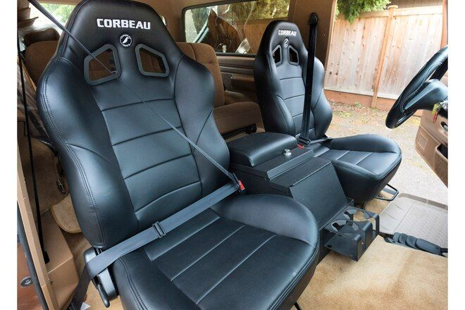 Our Trail Worn 91 Bronco Gets An Interior Refresh With Corbeau Bucket Seats And Lmc Truck Carpet Kit Seating Interior Photo Ford Bronco