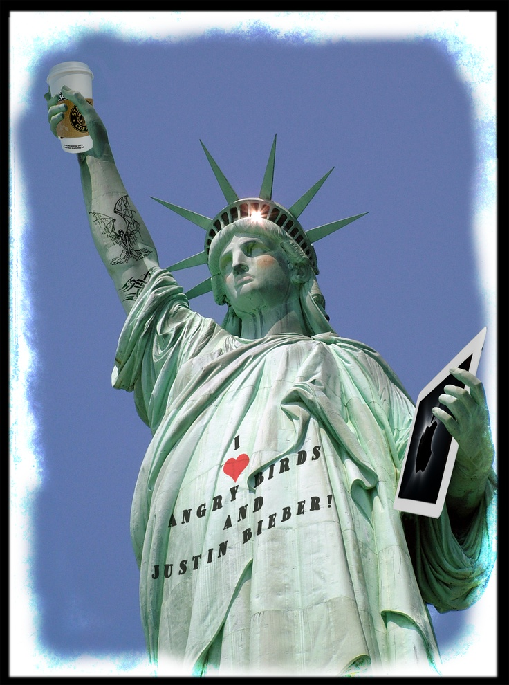 A modern Statue of Liberty with an iPad, Starbuck's coffee and a Justin Bieber logo tee.