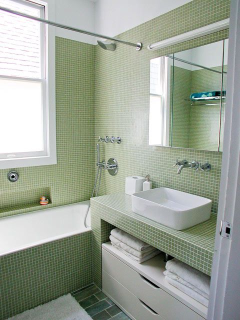 green tile bathroom....like the tile but i like the layout with the incorporated window...we have that horribly placed window too