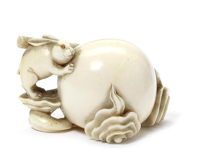 An ivory netsuke of the lunar hare By Shigemasa, Osaka, 19th century