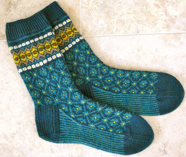pattern 'Flattery socks' and knitted with 2 skeins of Latvian mittenKnit Picks Tidepool Heather as main colour. Inspired by Latvian Mittens and can be found on ravelry