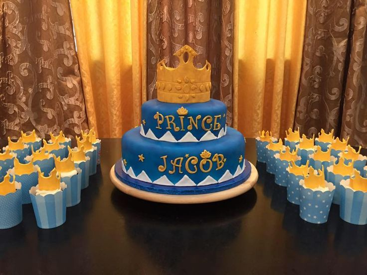 This is the cake and cupcakes I made for Jacob's first birthday yesterday. It's a two-tier cake and decorated with royal blue using airbrush technique. The crown is made of gum paste and brushed wi...