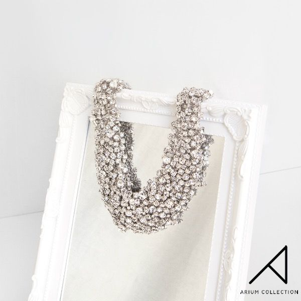 This intricate necklace adorned with crystals is the perfect complement to an LBD for a bold yet elegant statement.  100% Handmade In Korea.
