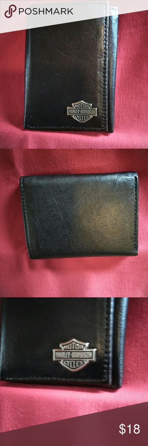 """Harley Davidson mens tri fold black leather wallet Harley Davidson mens tri fold black lambskin leather wallet. Lambskin is super soft leather. Never used. Still has HD card inside. Measures  3 1/2"""" x 4 1/2"""" close and 9 1/2""""x 4 1/2"""" when opened. Inside there's a clean I'd compartment 6 credit card slots and a divided bill slot. Harley-Davidson Bags Wallets"""