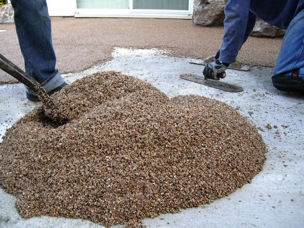 Laying a Pebble Patio  Give an old concrete patio a complete facelift with an overlay of pebbles mixed with epoxy. The result is a patio that looks like a sandy beach, giving the feel of an island resort in your own backyard.