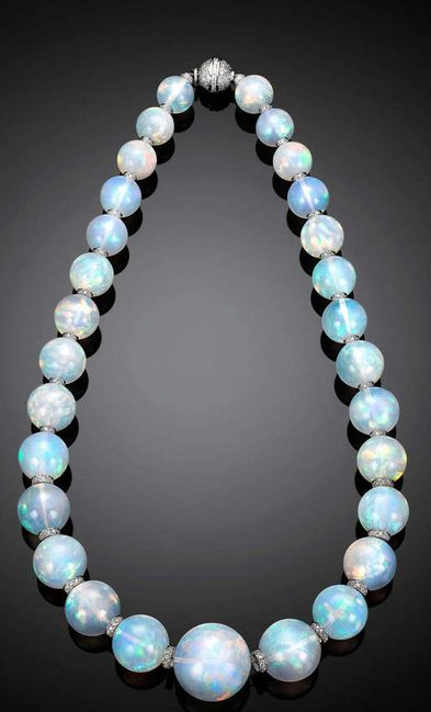 Ethiopian Opal and Diamond Rondell Necklace, Twenty-nine rare and large opal beads totaling an extraordinary 554 carats comprise this mesmerizing necklace. The graduated gems are an impressive size, measuring from 13mm to 23.8mm, with each exhibiting a high level of translucence and a rainbow of colors.