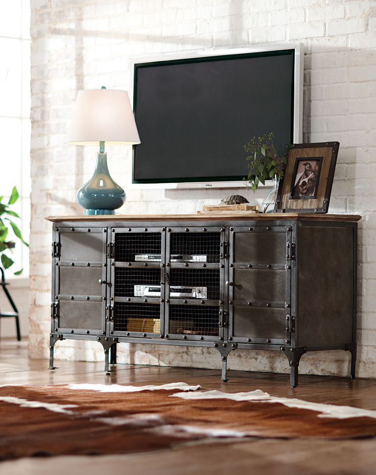 TV stand made stylish. It's the perfect complement to an industrial living room and makes the TV look so much better. HomeDecorators.com