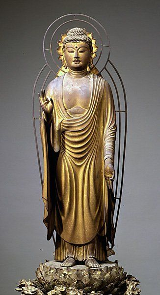 1202. Amida Nyorai by Kaikei. Kamakura-era saw greater simplicity and realism in Buddhist statuary. Hollow assembled woodblocks with polychrome, gold leaf, and crystal decoration. H 98.7 cm. Commissioned by Monk Chōgen. Tōdaiji Temple, Nara Japan.