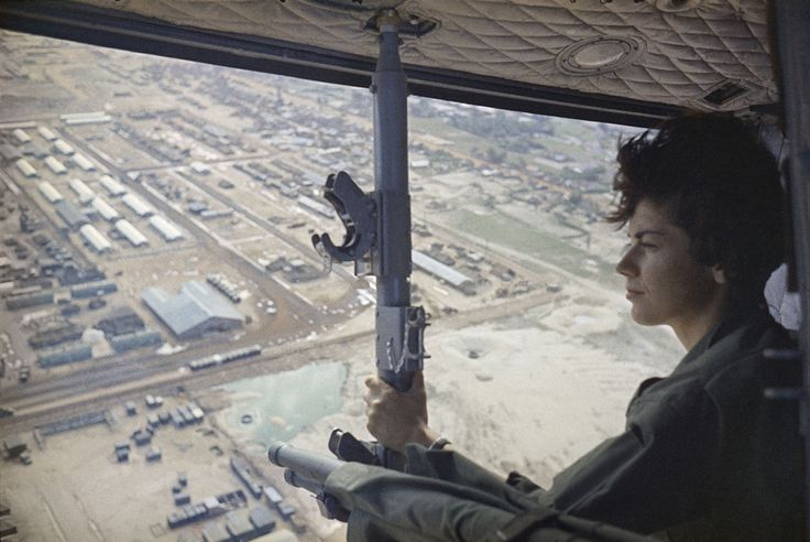 Army nurse 2nd Lieutenant Roberta Steele, 23, looks out from a medical helicopter in Qui Nhon, South Vietnam. February 9, 1966. .