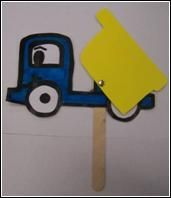 This is a photo of a craft design that has been made of the side view of a blue truck with a yellow dump bucket that has been attached with a brad. A stick has been attached to the bottom to make it a puppet.