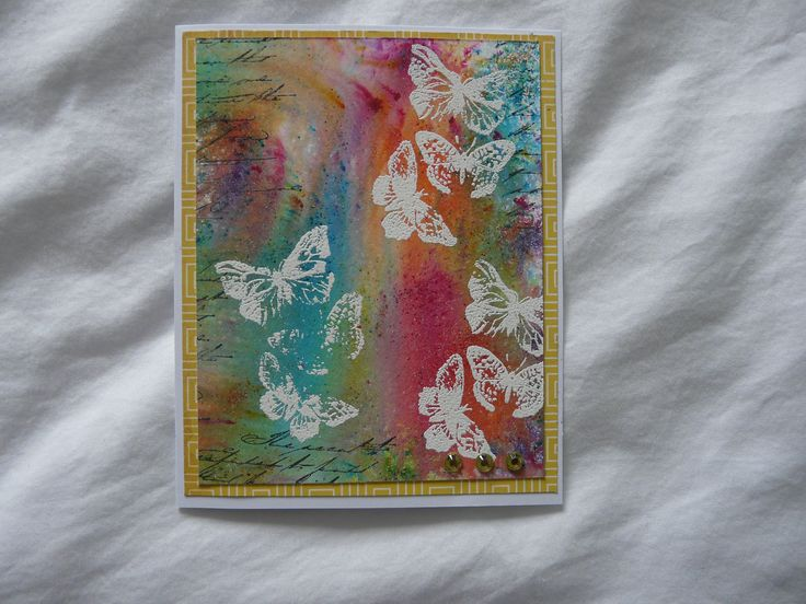 watercolouring with Magicals powders over embossed butterflies