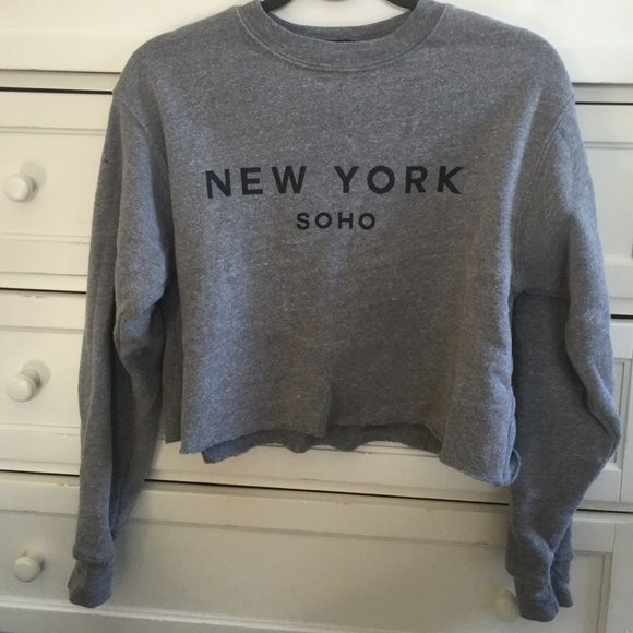 Brandy Melville grey soho cropped sweatshirt Grey cropped sweatshirt from Brandy Melville. Graphic says New York soho. New condition has just been sitting in my closet! No trades Brandy Melville Tops Sweatshirts & Hoodies