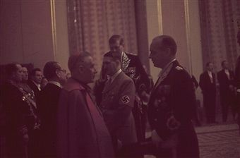 German Führer Adolf Hitler and Foreign Minister of the Reich Joachim von Ribbentrop in diplomatic dress greet with guests including Catholic papal nuncio Cesare Orsenigo of the Vatican at a New Year reception in Berlin in January 1st, 1939.