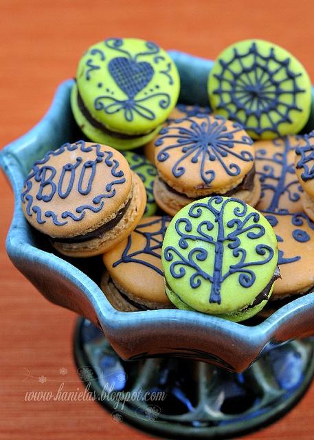 Spooktastically delightful orange and green Halloween Macarons. #macarons #cookies #food #Halloween #pastries #French #baking