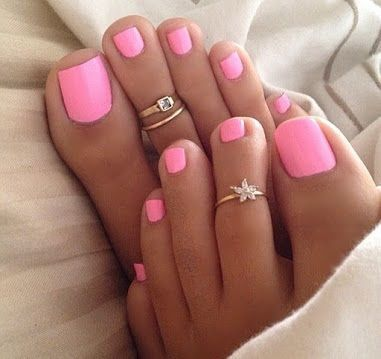 Beautiful Pink Toenail Polish Color This is a very pretty set of feet that have on a very nice pink color nail lacquer. Pink seems to be a favorite color of mostly everyone, and it
