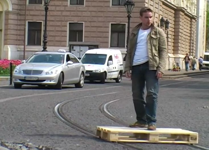 tomas moravec hacks a wooden pallet to glide down tram tracks
