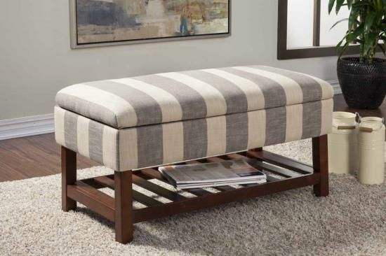Grey and beige lined fabric upholstered bedroom ottoman bench with brown wood frame