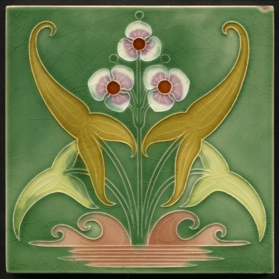 Art Nouveau Molded Majolica Tile Gibbons Hinton Stourbridge c.1910. An unusual art nouveau design both stylistically and how often seen. Unusual colouring too, seven colours makes it a rarity for only a handful of designs have as many. Illustrated on the reprinted catalogue page in Austwick. With a moulded outline without further relief the outline very sensitively created giving subtlety difficult to achieve with tubeline.