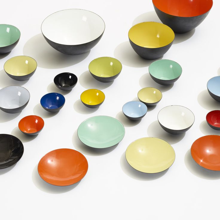 Lot 164: Herbert Krenchel. Krenit bowls, set of twenty-eight. 1953, enameled steel. 9¾ dia x 5½ h in. result: $3,500. estimate: $2,000–3,000. Collection includes twenty-eight bowls of varying sizes and two serving utensils, 30 pieces total. Signed with cast manufacturer's mark to each server: [Krenchel Denmark].