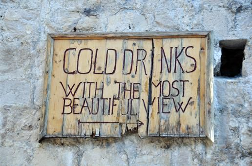 Sign for the Café Bar Buža in Dubrovnik, Croatia, which Rick Steves describes as 'the most scenic spot for a drink in Dubrovnik