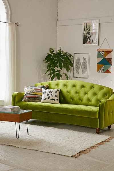 I love the green of the Adeline Storage Sleeper Sofa as it adds a fresh look to a rather neutral palette in this lounge.