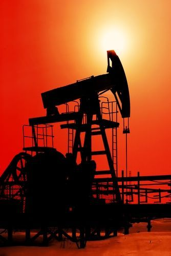 Oil rig in west Texas pictured against the sunset I put $100,000.00 in they better have oil there