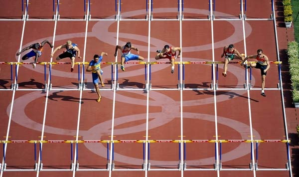 Athletes compete during 110m hurdles competition of men's decathlon - Beijing Olympics 2008