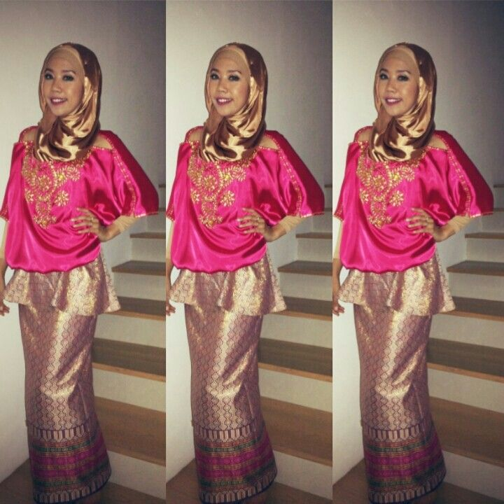 On my engagement day. I love to wear fuschia and gold, it makes my dark skin glow. And gold looks really grand for an occasion whether day or night. A very happy engage girl I am;)