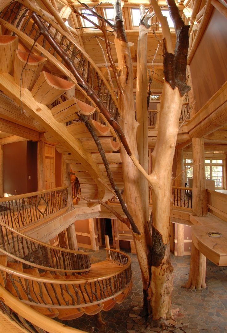 This three story log cabin with spiral log stairs