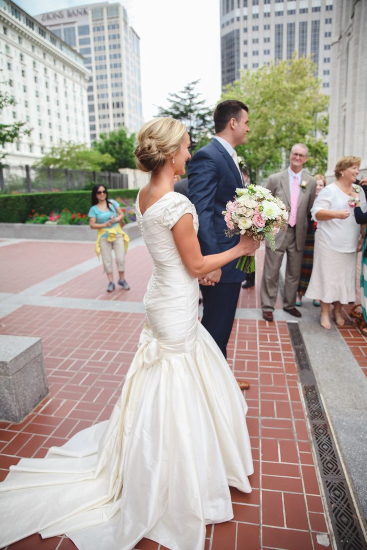modest wedding dress with tight fit.